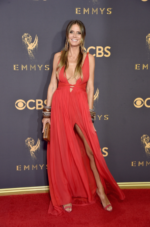 When you're an international supermodel, it's pretty hard not to look fantastic on the red carpet. Heidi Klum did not disappoint and wowed us yet again in this red gown (by Dundas). She accessorized with bohemian chic wooden bangles and a clutch. Steal her look and pick up some wooden bangles for yourself! Perfect for stacking or wearing alone.